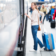 Boarding a train with a suitcase